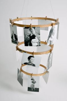 With a little creativity, a few embroidery hoops and clothespins can become a simple and chic photo mobile.