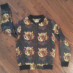 Tiger Bomber Jacket Black and tiger head print bomber / flight jacket. Fun jacket, great fit. Polyester. S/M. Jackets & Coats