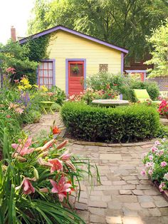 A perfect example of how a simple structure can be gorgeous with the right paint colors and gardens.