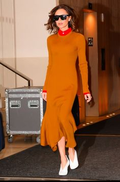 Loving the fluted, midi-length dress...and those shoes! (Victoria Beckham's Been Trying to Get You to Check Out Her Shoes)