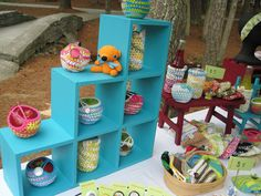 Shelving units for apple cozies and amigurumi (the tiny table behind and some baskets too)