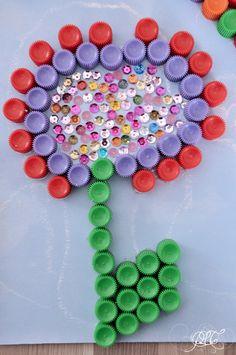 Prendre le temps - Tableau coloré en bouchons de compote - Fleur