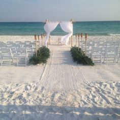 Beautiful and simple beach wedding :)  Would also be beautiful with a lighthouse(: awwwwwhhh