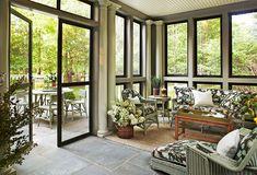 Screen porch - bluestone floor, black trimmed screens - Traditional Home