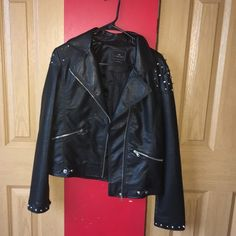 Studded Moto Jacket 10/10 condition. All studs in tact. Large but fits more like a medium. This jacket will definitely bring out your inner rockstar! Willing to bundle.  Fast shipping  Cheaper on Ⓜ️ Jackets & Coats