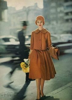 Model wearing a Vogue Patterns suit by Milliken, August 1958