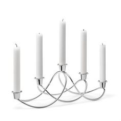 The Harmony candle holder was designed by Maria Berntsen for the Danish brand Georg Jensen. The candleholder has a soft, elegant shape and is a real statement for the dinner table for window sill. Harmony has space for 5 candles and is a timeless Scandinavian design classic.