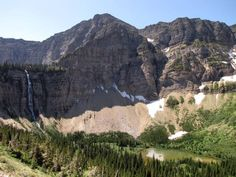 The emerald lake at the base of Crypt Falls rests majestically below Mount Boswell in Waterton Lakes National Park, Alberta, Canada.