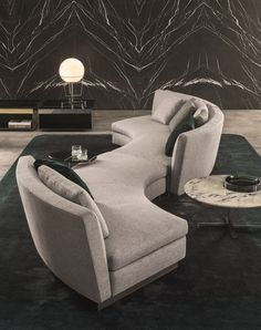 Soft shapes inspired by a dynamic and sinuous architectural language. Seymour, the seating system designed by Rodolfo Dordoni for Minotti