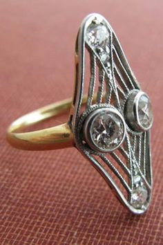 Erica Weiner 1930s Shield Diamond Ring, $1,950, available at Erica Weiner, 173 Elizabeth Street (between Spring and Kenmare streets); 212-334-6383.