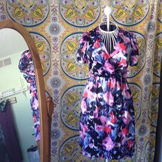 NWOT Silk Floral Banana Republic Dress 0P Absolutely perfect. Please feel free to make an offer! I'm happy to answer any questions you may have or help you bundle up a few of your favorites at a discounted price!! :) Banana Republic Dresses