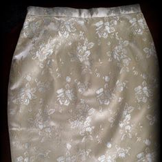 Gorgeous Jessica McClintock skirt Light gold floral design with gold threading. Satin base material. Zipper and button closure in back and slit at bottom of back. Fully lined inside. Jessica McClintock Skirts A-Line or Full