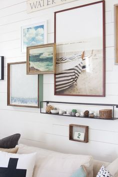 Coastal images like the ones in this living room will give it that beach cottage appeal.