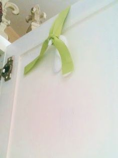 Use a hook, upside down, to hang a wreath on a cabinet door. Loop the ribbon onto the hook!