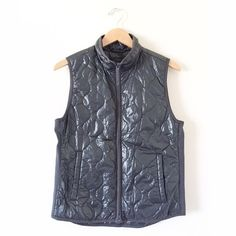 NWOT JCrew Layering Vest w/ Primaloft in Black, M This vest is sleek and slim! Super trendy. It's super warm but very slim and lightweight. Perfect for layering. See photo for product detail from JCrew. Never worn, no stains, snags, or pilling of any kind. J. Crew Jackets & Coats Vests