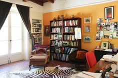 one tangerine wall and lots of books...