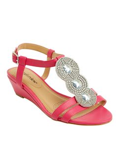 An antique, metal-like ornament gives this sandal a pretty touch! We carry this sandal in wide and wide wide widths.