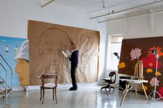 Through visits to artists' studios and explorations of inspirational landscapes, Art Studio America provides a privileged look at the dreams, ideas and thoughts of 115 artists practising today. While the world may know their work well, they have rarely, if ever, allowed their personal landscapes to be seen in such an intimate manner. In this image: Alex Katz in his studio.