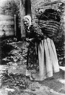 Lady carrying peat home while knitting! Remember her next time you feel overworked.