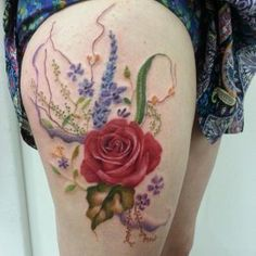 Rose tattoo with extras on thigh by Jemka