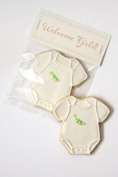 Pin for Later: 21 of the Cutest Baby Shower Cookies Ever! Welcome Girls Cookies Sweet Kiera's cookies featuring two peas in a pod on a sweet onesie would make the perfect favor for a twin shower.  Source: Sweet Kiera