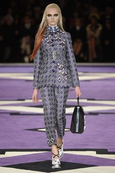 Pin for Later: 34 Reasons Why We Want to Live in Prada's Whimsical World Fall 2012 Bold printed pantsuits took over the Fall '12 runway in an array of vibrant hues.