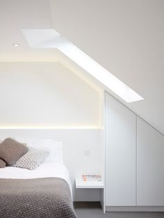 Simple, elegant, efficient use of under eaves space // Contemporary Bedroom by Carlson Stenner Architects