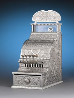 This antique detail adder cash register by the National Cash Register Co. (NCR) of Dayton, Ohio, is a fantastic piece of Americana. The beautiful nickel-over-iron case and original top sign are designed in the firm's Ionic motif. This particular machine, model number 11, is a detail adder, and is one of the first registers NCR ever created.