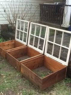 I can totally make these Mini Greenhouses! I have the glass windows. Just build a simple wooden frame using the junk-lumber we have laying around, attach the glass windows with hinges, place over the dirt in the garden, plant lettuce, carrots, kale, etc. I'm excited about this!