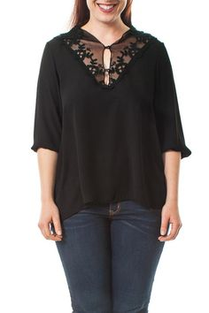 V-neck 3/4 sleeve top, floral embroidered mesh neckline that features two button down front, V-shape back mesh and asymmetrical hem (slightly shorter in front, with hem longer in back). Wear this light weight top on a warm day to stay cool.     Floral Embroidered Top by Bluebell. Clothing - Tops - Blouses & Shirts Florida