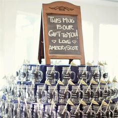 Amber and Scott deiced to have their wedding favors also serve as the seating chart and guests' drinking glasses for the night. They used chalkboard paint and wrote guests' names on their glasses. They also added striped paper straws with flags that indicated their table numbers. The chalkboard on top was made by the bride's grandfather.
