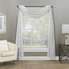 Bringing a romantic look to your living space, the Sierra Sheer Rod Pocket Window Curtain Panel features a woven lace design that subtly lets in sunlight. Natural finish complements the décor and its polyester fabric is machine washable. Sheer Valances, Sheer Drapes, Scarf Curtains, Drapes Curtains, Bay Window Curtains Living Room, Window Swags, Living Room Decor Set, Rod Pocket, Living Spaces