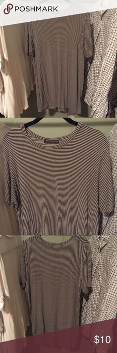 Striped Tee Really comfy striped tee. A classic Brandy Melville top. Worn a handful of times. 60% cotton 40% micromodal. Brandy Melville Tops Tees - Short Sleeve