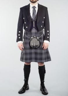 FEATURES Made from 8 yards of material Woven from Polyester, Rayon tartan cloth cotton waist lining 3 leather straps for adjustable fastening 3 belt loops Standard drop Pleated to sett SIZE GUIDE DELIVERY & RETURNS Men In Kilts, Kilt Men, Kilt Wedding, Black Kilt, Le Kilt, Tartan Kilt, Scottish Kilts, Modern Man, Grey