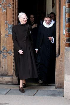 Royal highness: Margrethe wore an ankle-grazing dark brown coat paired with embellished su...