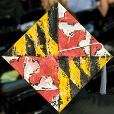 FIDM Graduates decorate their mortar boards for the 2012 FIDM Graduation Ceremony held at the Staples Center in Downtown Los Angeles.