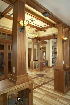 This Colorado Springs custom home entry way in craftsman decor was custom crafted by Brian Hubel. Its one of those like but don't like regarding all that wood Craftsman Lighting, Craftsman Decor, Craftsman Trim, Craftsman Interior, Craftsman Style Homes, Craftsman Bungalows, Craftsman Houses, Craftsman Style Interiors, Bungalow Homes