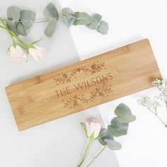 Personalised Floral Wooden Serving Board Gift  This personalised wooden chopping board makes the perfect couples gift. The design features the couples family name with pretty leaf motifs and a love heart at the top. Find it at @normaanddorothy  #choppingboards #cheese #giftideas #woodwork #kitchenaccessories #cheeseboards #handmade #cuttingcheese #boards #cuttingboards #craftsmanship #personalisedgifts #engraving #homewares #woodengifts #oak #stylematters #amatterofstyle
