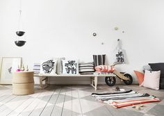 stenciled wood floors, white walls, graphic elements