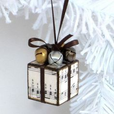 Small Sheet Music and Jingle Bells Decorated Ornaments: Decoupaged a tiny cube wood block with sheet music and finished with jingle bells. It is then to be this cutest ornaments for rustic Christmas decoration or used as gifts.