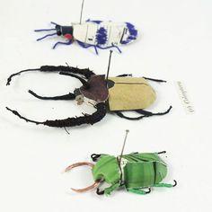 Paper beetles by artist Kate Kato (kasasagi).