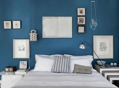 Mixed decoration with pictures, frames, lamps, and drawings on a blue painted wall via For Interieur Blue Rooms, Blue Bedroom, Blue Walls, Master Bedroom, Bedroom Decor, Sweet Home, New Homes, House Design, Interior Design