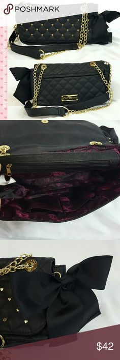 """Betsey Johnson Gold Black Quilted Purse Handbag Betsey Johnson Gold Black Quilted Purse Handbag in excellent used condition. Three compartment purse with flap snap closure. Cute gold hearts and black side bow. Purple liner. Measures 7"""" x 11"""" and 3.5"""" wide.  Please let me know if you have questions. Happy Poshing! Betsey Johnson Bags Shoulder Bags"""