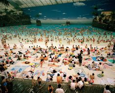 The Artificial beach inside the Ocean Dome, Miyazaki, Japan. From 'Small World', 1996 © Martin Parr / Magnum Photos. British photographer Martin Parr has been capturing satirical slices of day-to-day life for over 40 years with his a never-ending passion for street/documentary photography. http://www.martinparr.com | https://pro.magnumphotos.com/Asset/-2S5RYDY0W7HN.html