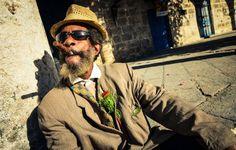 Old man puffing cigar, Havana.