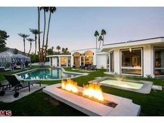 A posh and elegant #backyard equipped with a unique fireplace and pool. Palm Springs, CA Coldwell Banker Residential Brokerage