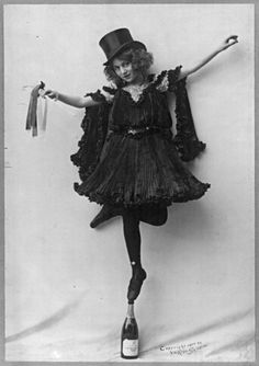 Model posed in standing tip-toe on a champagne bottle, 1902.  (The Library of Congress)