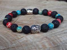 Barevný Buddha náramek z přírodních regalitových korálků v barvě červené a tyrkysové a s lávovými korálky.  Velikost cca 17 cm. Navlečeno na pružném elastomeru. Buddha, Beaded Bracelets, Jewelry, Jewlery, Jewerly, Pearl Bracelets, Schmuck, Jewels, Jewelery
