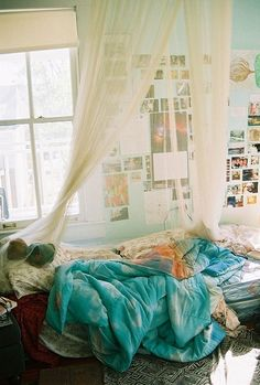 i like the mattress on the floor, canopy, and all the photos on the wall.