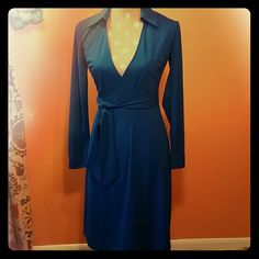 Royal Blue Wrap Dress Beautiful blue dress accentuates all the right places.  Heavier material definitely meant for colder weather.  In excellent used condition. Express Dresses Long Sleeve